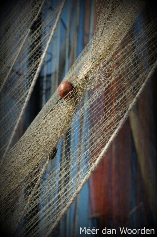 in de touwen